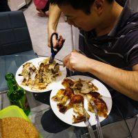 Jason cutting Chicken in pieces